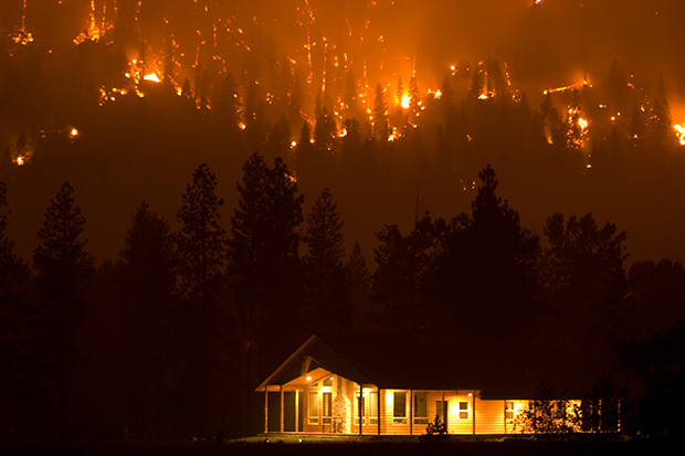 The Pioneer Fire burns towards a house