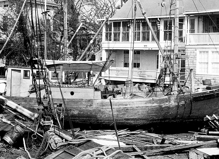 Historic photo of an ocean-going vessel deposited into a neighborhood yard.
