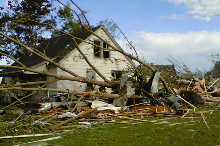 tree on house in Canada following tornado
