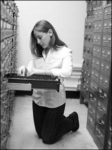 Woman searching card catalog