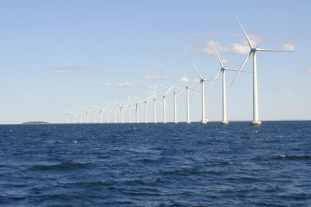 A receding line of offshore wind turbines near northern Denmark
