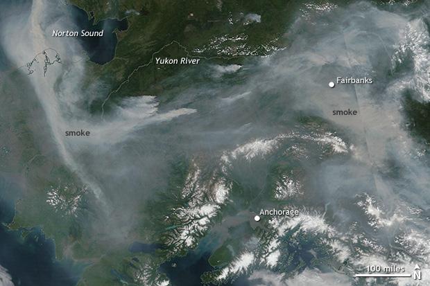 Photo-like satellite image of Alaska shrouded in smoke