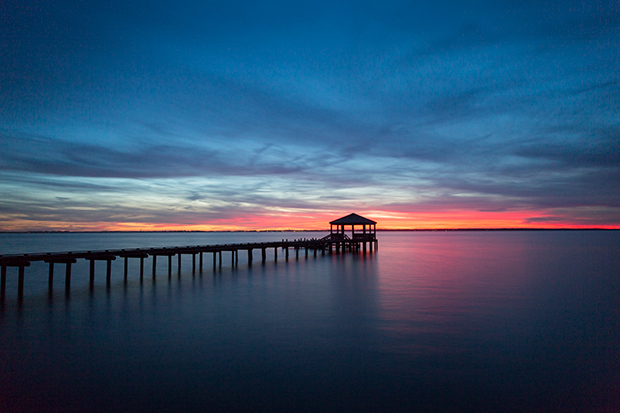 Photo of a long pier and gazebo on Albermarle Sound at sunset