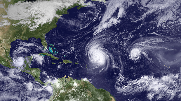 satellite image of a trio of hurricanes in the Atlantic and Caribbean Sea in 2010