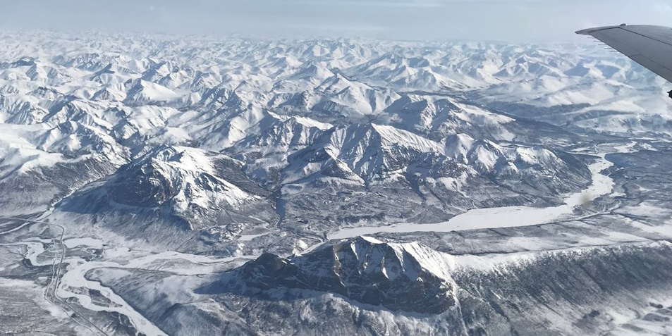 Photo of snow-covered mountains receding into distance