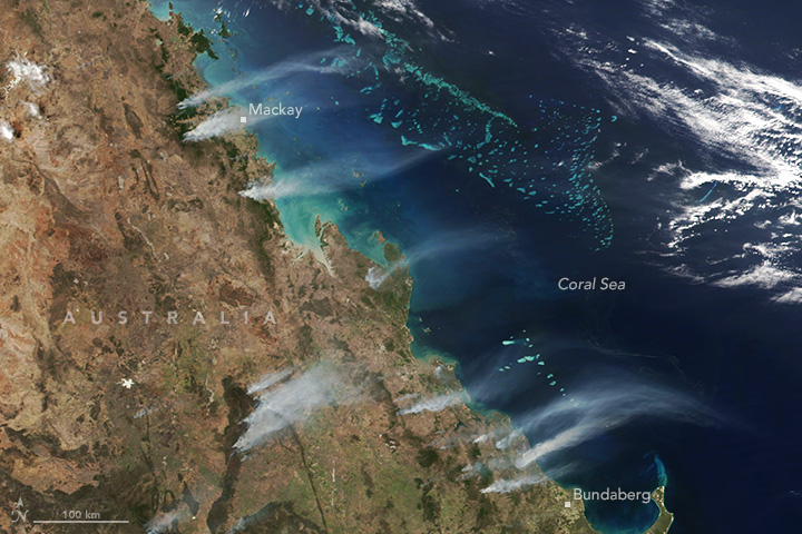 Satellite image of the central eastern coast of Australia showing smoke plumes drifting over the Coral Sea
