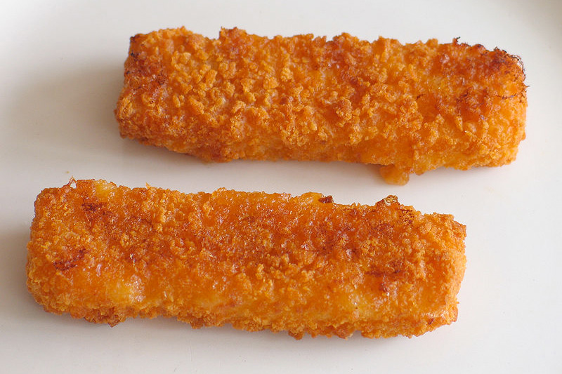close up photo of two cooked fish sticks