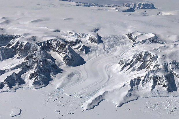 aerial photo of a glacier flowing off the West Antarctic Ice Sheet into the Bellinghausen Sea