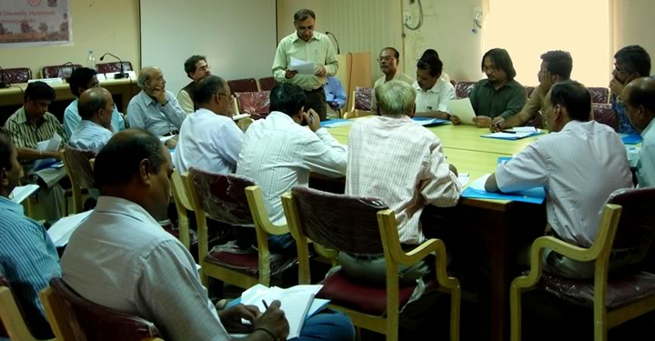 Photo of workshop participants seated at a roundtable