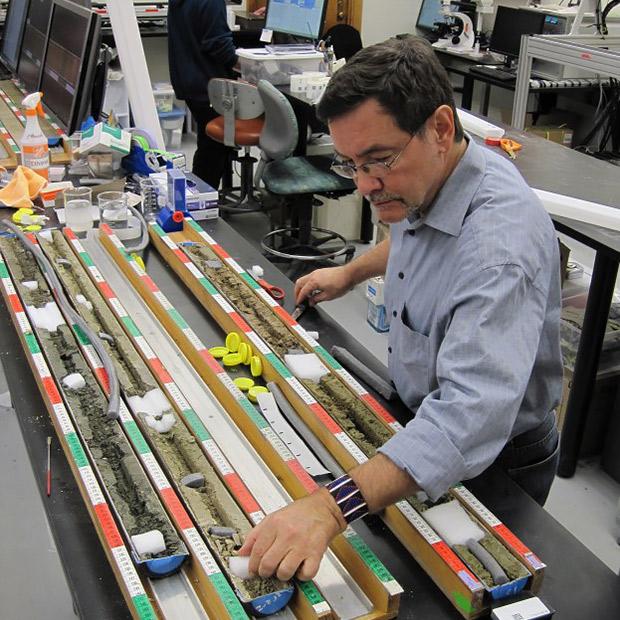 Rick Potts examining sediment cores