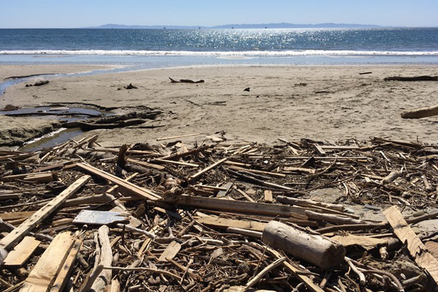 Photo of piles of boards and other debris on California's Summerland beach